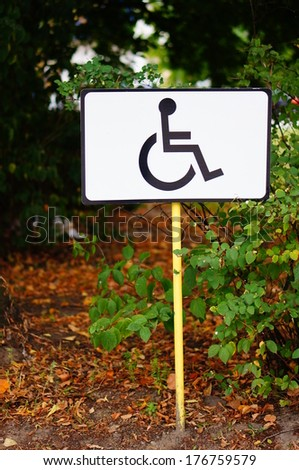 Parking sign showing a wheelchair symbol - stock photo