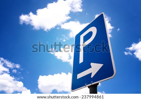parking sign with blue sky and clouds - stock photo