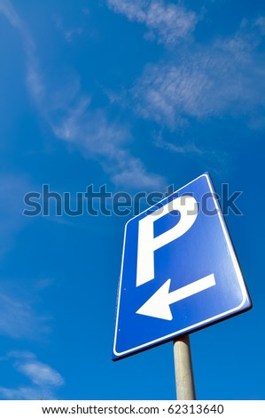 Parking signal in the blue sky - stock photo