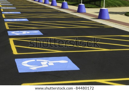Parking spaces reserved for the disabled in outdoor lot for the public - stock photo