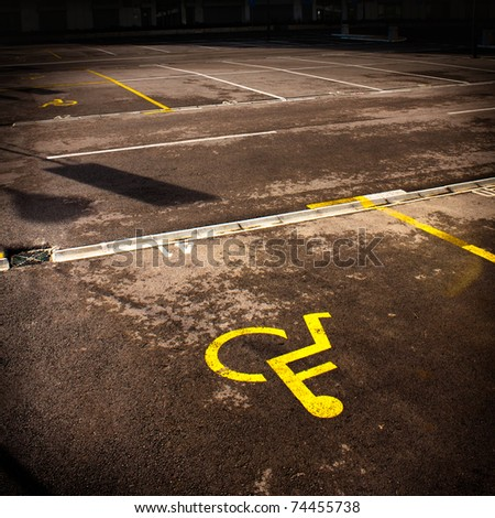 Parking symbol for persons with physical disability. Sign is in yellow color. - stock photo