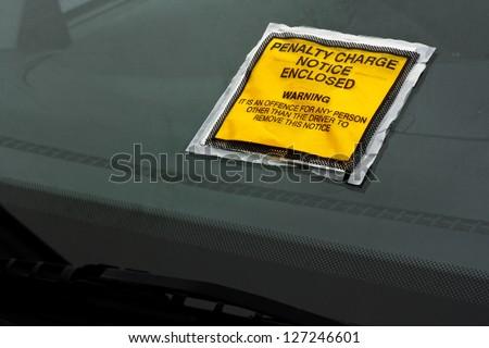 Parking ticket stuck on car windscreen a penalty or fine - stock photo