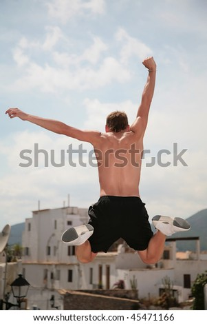 Parkour, man jumping from buildings - stock photo