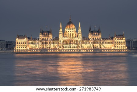 Parliament building in Budapest, Hungary in evening lights. This image is toned. - stock photo