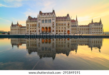 Parliament building in Budapest on a sunset with reflection in fountain - stock photo