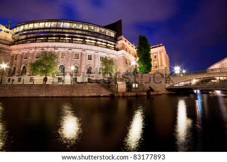 Parliament building in Stockholm, Sweden at night with water reflection - stock photo