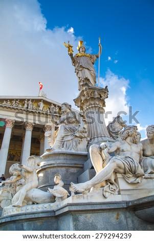Parliament building in Vienna, Austria and statue of Pallas Athena Brunnen - stock photo
