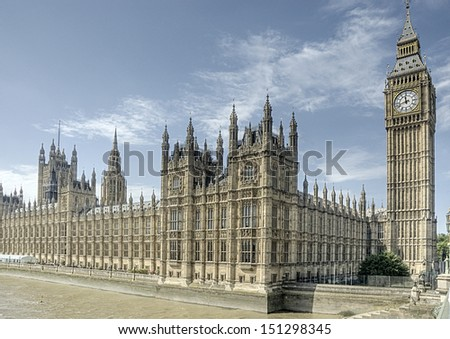 Parliament buildings, including the Big Ben tower in London, UK. - stock photo