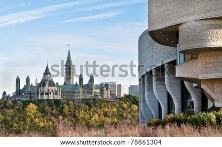 Parliament Hill in autumn with the civilization museum in the foreground. - stock photo
