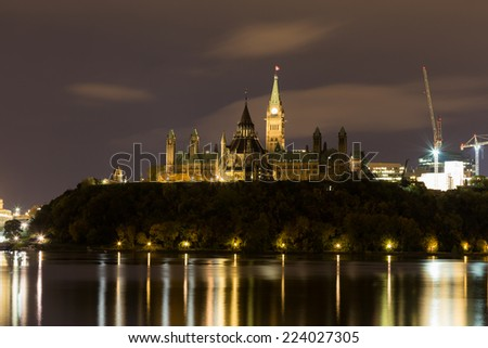 Parliament Hill in Ottawa at night with copy space - stock photo