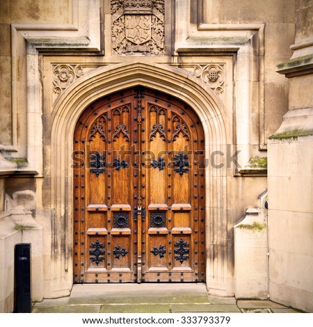 parliament in london old church door and marble antique wall - Parliament London Old Church Door Marble Stock Photo 424780243