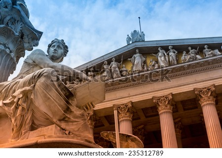 parliament in vienna, austria. seat of government. statue of pallas athena, goddess of weiheit. - stock photo