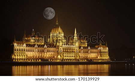 Parliament of Budapest, Hungary at night by the full moon - stock photo