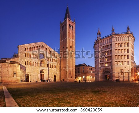 Parma Cathedral (Duomo) and the beautiful Baptistery (Battistero) in Emilia Romagna, Italy, illuminated at dusk.