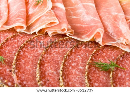 Parma ham and salami slices - stock photo