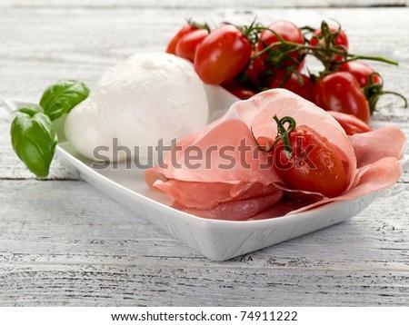 parma ham with mozzarella and tomatoes - stock photo