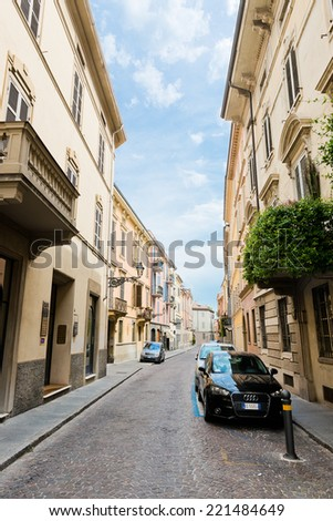 PARMA, ITALY -JULY 20 2014: Old beautiful nice street in Parma. Italy. Parma is a city in the Italian region of Emilia-Romagna famous for its prosciutto (ham)