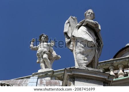 PARMA, ITALY - MAY 01, 2014: Saint and Angel. Basilica Santa Maria della Steccata. Basilica is a Marian shrine made in Parma between 1521 and 1539 and in 2008 elevated to the rank of minor basilica  - stock photo