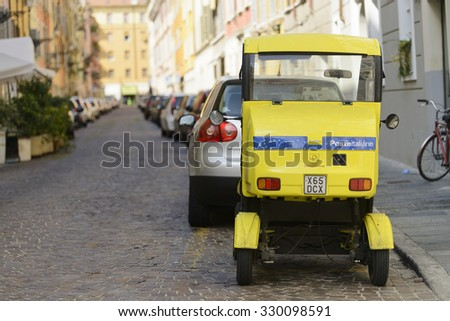 Parma, Italy, - September 14, 2015: One of the Poste Italiane vehicles used by postal workers in Parma as the travell about the city delivering mail. - stock photo