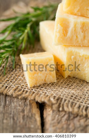 parmesan chees on wooden surface - stock photo
