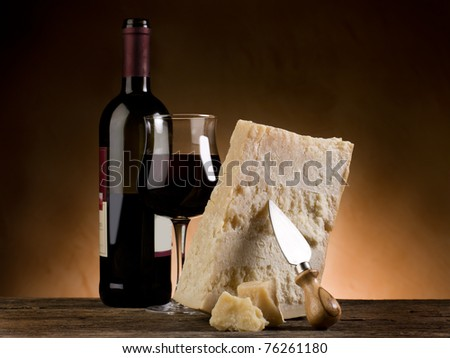 parmesan cheese and red wine - stock photo