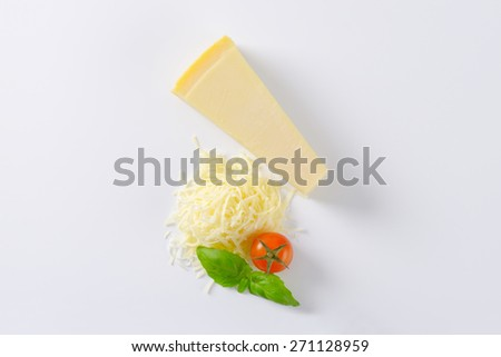 parmesan cheese, cherry tomato an basil on white background - stock photo