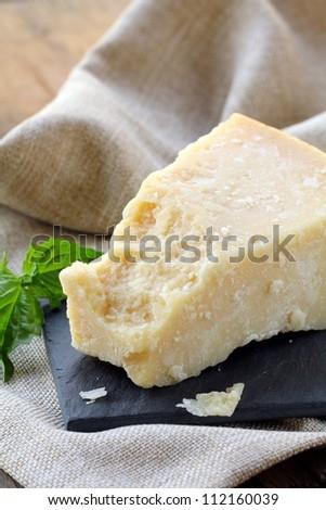 Parmesan cheese - hard Italian cheese - stock photo