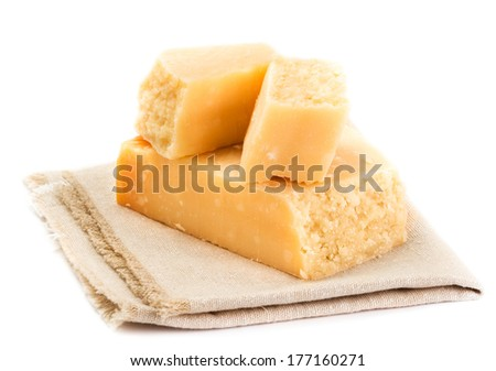 Parmesan Cheese  Isolated on White Background close up. Piece of Parmesan cheese on a napkin, studio shot. - stock photo