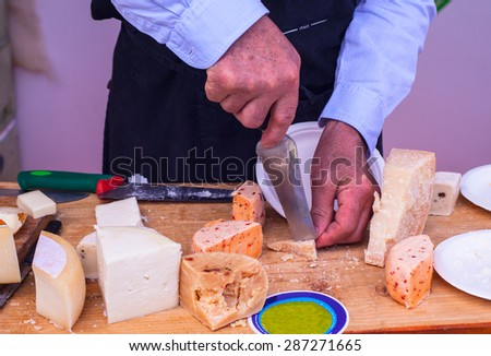 Parmiggiano and others Italian cheeses in the street market - stock photo