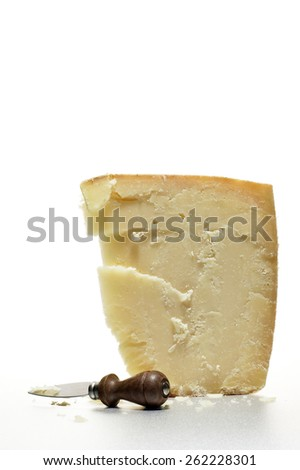 Parmigiano Reggiano Cheese Wedge with Knife - stock photo