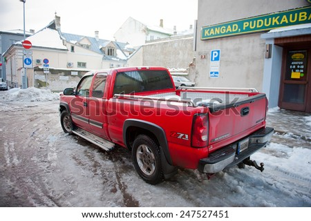 PARNU - DEC 31: Chevrolet Silverado on Dec. 31, 2014 in Parnu, Estonia. The Chevrolet Silverado and the GMC Sierra is a series of full-size and heavy-duty pickup trucks manufactured by General Motors. - stock photo