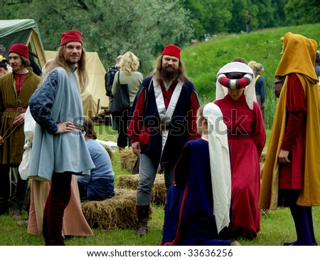 PARNU, ESTONIA - 28TH OF JUNE 2009 : Participants in medieval clothes get ready to participate during 29th International Hanseatic Days 26-28 June 2009 in Parnu, Tallinn, Estonia. - stock photo