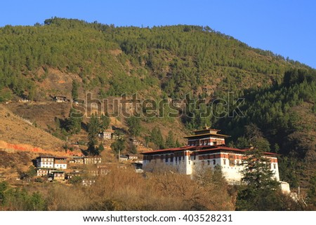 Paro Rinpung Dzong, Buddhist monastery and fortress, on a hill above a river Paro Chu near to the city Paro - stock photo