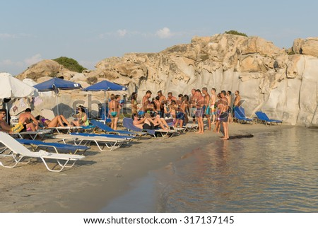 Paros, Greece, 06 August 2015. Tourists and local people having fun at Kolimbithres beach in Paros island.