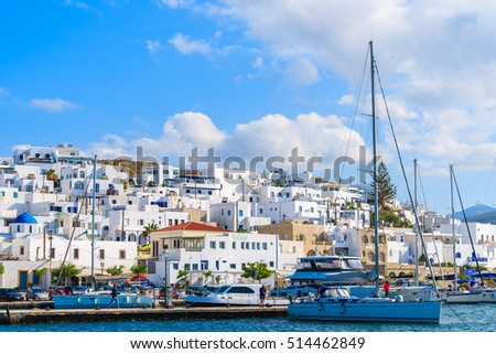 PAROS ISLAND, GREECE - MAY 18, 2016: Sailing boats anchoring in Naoussa port on Paros island, Greece.
