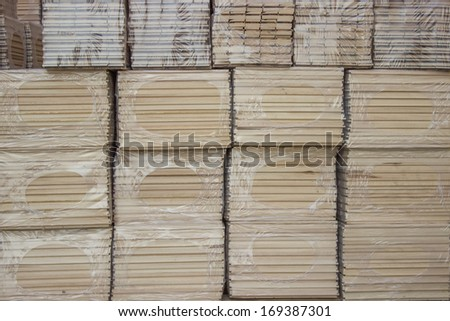 Parquet blocks, supplied unfinished and in a tile format backed onto mesh for easy installation. Package of Beech wood profiles. - stock photo