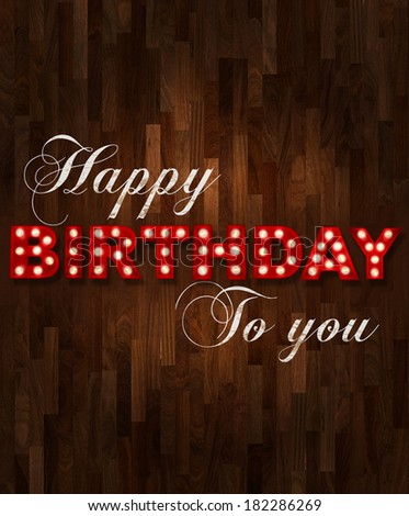 Parquet floor background with glowing letters writing Happy Birthday to you - stock photo