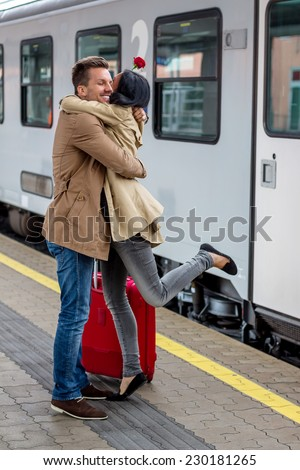 parr on arrival or verabschiedeung on a platform at a station - stock photo