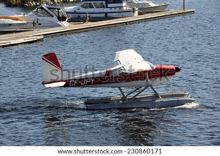 Parry Sound, Ontario, Canada - September 29, 2014: Georgian Bay Airways floatplane readying to takeoff at Parry Sound waterfront. - stock photo