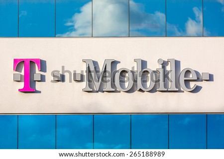 PARSIPPANY, NJ, USA - MARCH 30, 2015: Facade of the T-Mobile USA regional headquarters. T-Mobile USA, a subsidiary of T-Mobile International AG, is one of the four national wireless carriers. - stock photo