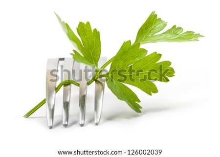 Parsley and fork isolated on a white background