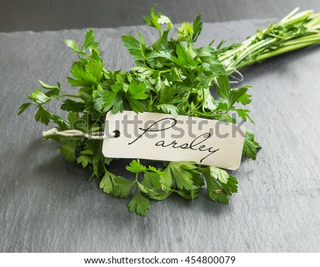 Parsley aromatic herb bunch with label - stock photo