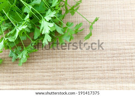 Parsley on a wooden table - stock photo