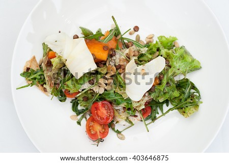 Parsnip Salad with Sectioned Tomato served on a white plate