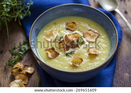 Parsnip soup with parsnip crisps and thyme - stock photo