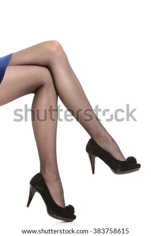 Part body of woman. Slim attractive gorgeous female legs in black pantyhose tights and high heels shoes isolated on white. - stock photo