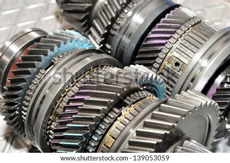 Part from  car gearbox on aluminium plate. - stock photo