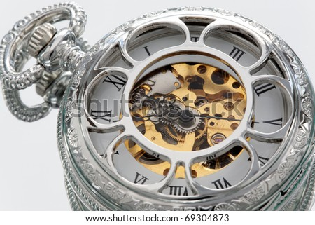 Part of a antique mechanical pocket watch. - stock photo
