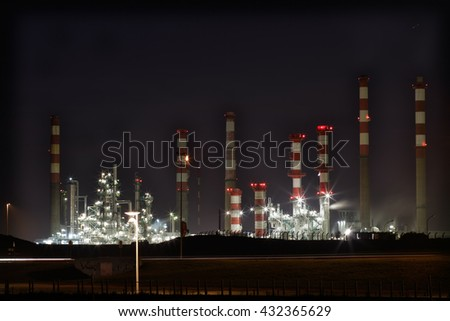 Part of a big oil refinery and powerplant by night