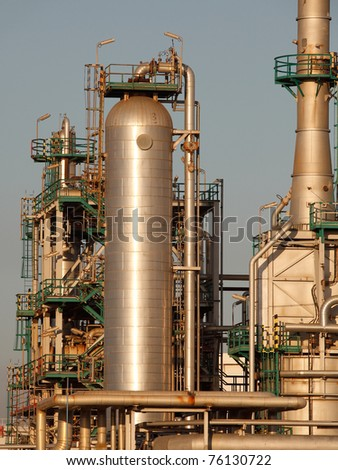 Part of a big oil refinery and powerplant under seeing aluminum tanks, tubes and pipes